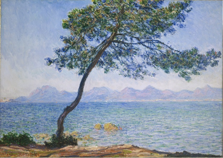 A painting of a coastline. There is a tree in centre of the foreground, calm blue sea and mountains in the background.