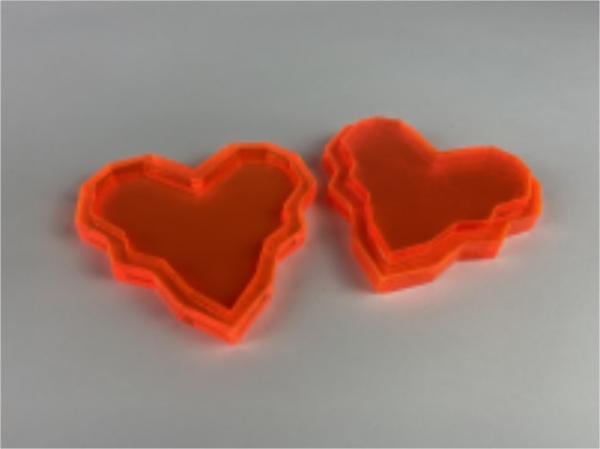 Laser cut 3D hearts in orange acrylic