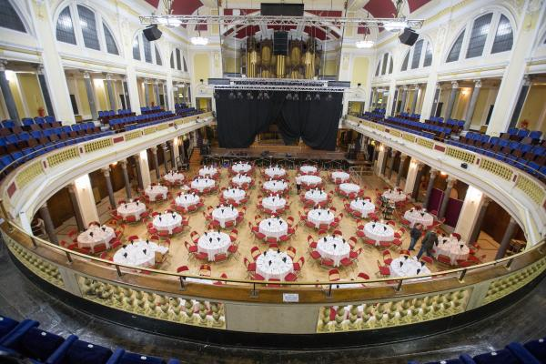 picture of a hall with tables and chairs